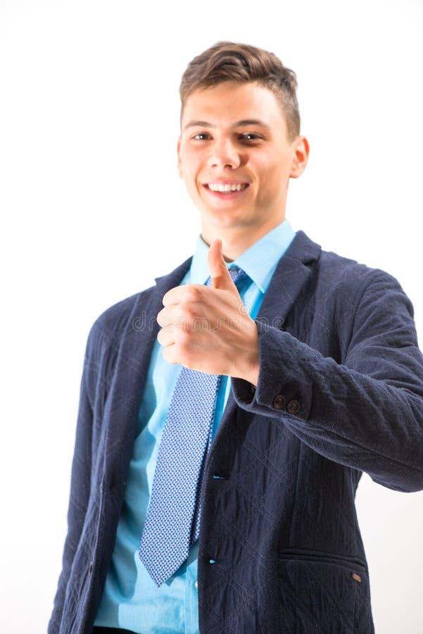 Ευτυχής έφηβος που κάνει σήμα ΕΝΤΆΞΕΙ με τα χέρια του που απομονώνονται στοκ φωτογραφίες