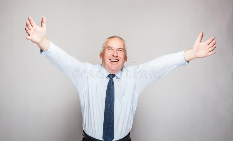 Ευτυχής ανώτερος επιχειρηματίας στοκ εικόνες