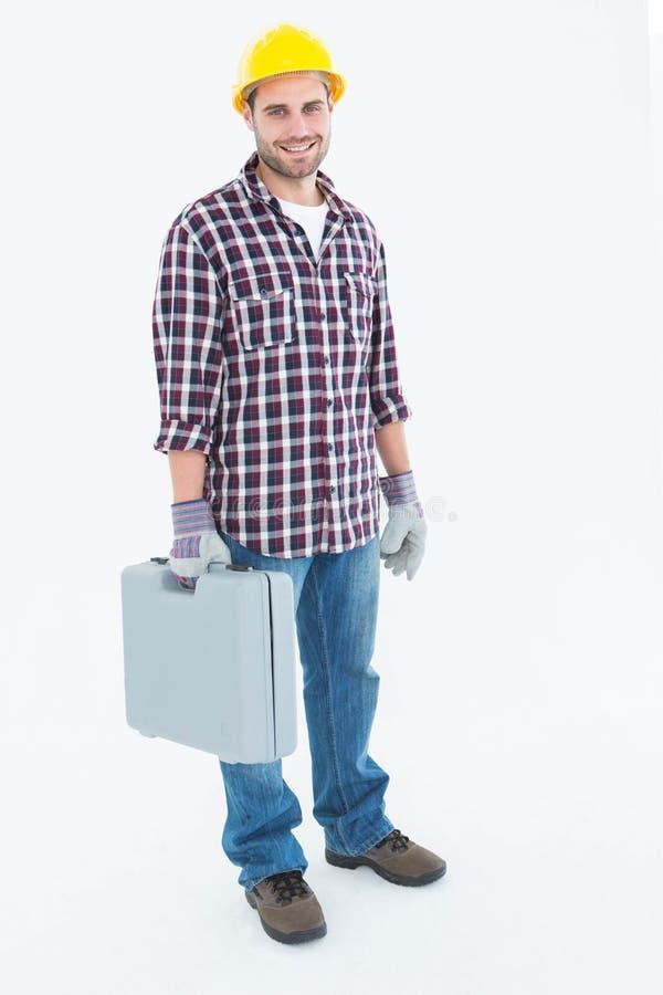 Ευτυχής αρσενικός handyman με την εργαλειοθήκη στοκ φωτογραφίες με δικαίωμα ελεύθερης χρήσης