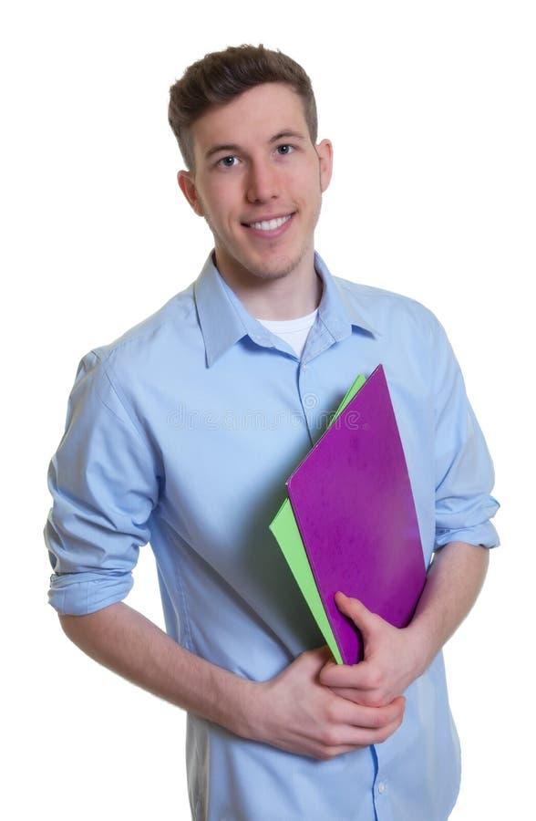 Ευτυχής αυστραλιανός σπουδαστής με τη γραφική εργασία στοκ εικόνα