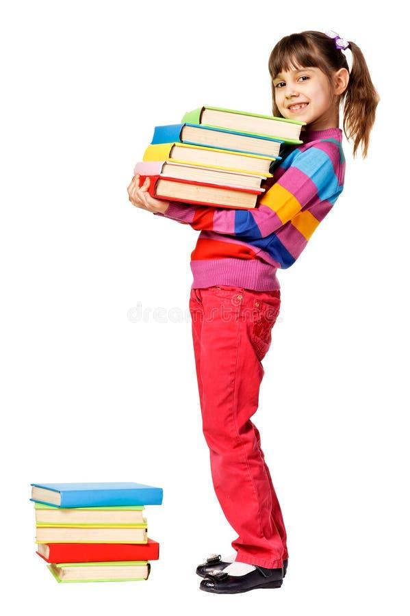 ευτυχής βαριά στοίβα μαθητριών βιβλίων στοκ εικόνες με δικαίωμα ελεύθερης χρήσης