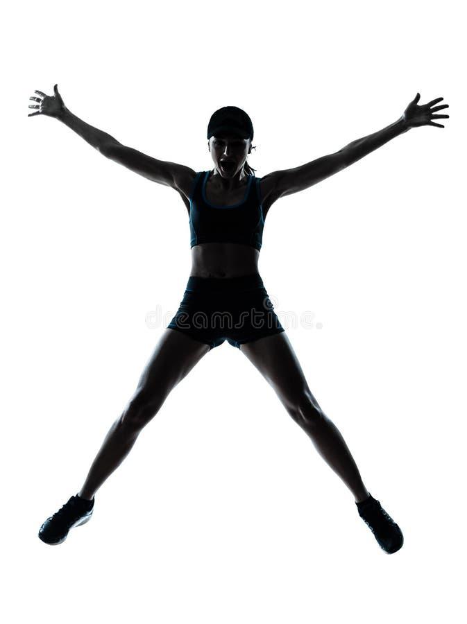 ευτυχής γυναίκα δρομέων jogger πηδώντας στοκ εικόνα