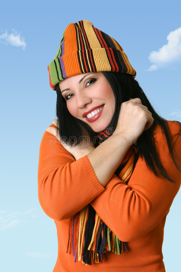 ευτυχής γυναίκα καπέλων woolly στοκ φωτογραφία με δικαίωμα ελεύθερης χρήσης