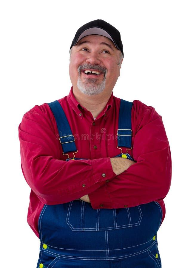 Ευτυχής επιτυχής αγρότης που ανατρέχει στοκ εικόνα