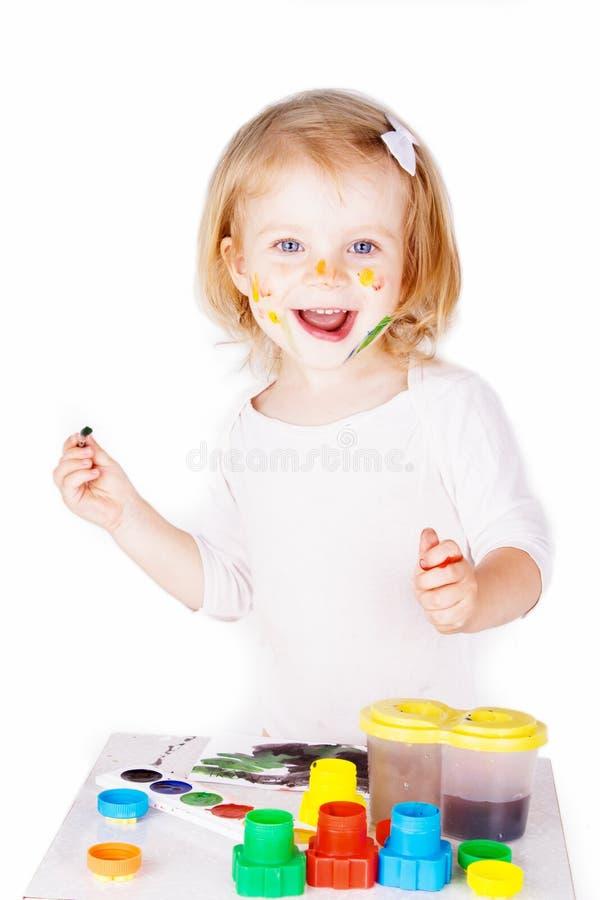 ευτυχής ζωγραφική κοριτσιών στοκ φωτογραφία