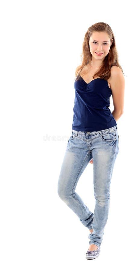 Ευτυχής νέα γυναίκα που στέκεται το πλήρες μήκος που απομονώνεται στο άσπρο backgro στοκ φωτογραφία με δικαίωμα ελεύθερης χρήσης