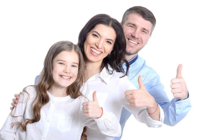 Ευτυχής νέα οικογένεια σε ένα άσπρο υπόβαθρο στοκ εικόνες