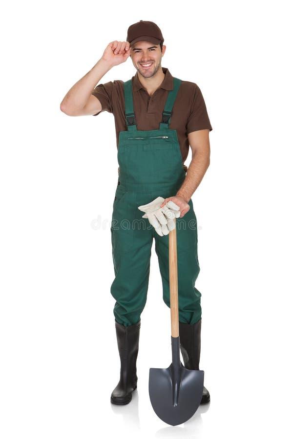 Ευτυχής νέος κηπουρός στα dungarees στοκ εικόνα
