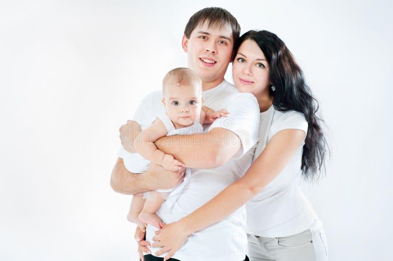 Ευτυχής οικογένεια με ένα μωρό στοκ φωτογραφία