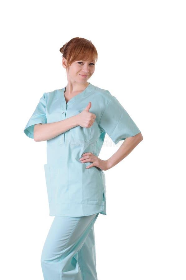 Ευτυχής χαμογελώντας θηλυκός γιατρός με τους αντίχειρες επάνω στη χειρονομία στοκ εικόνες