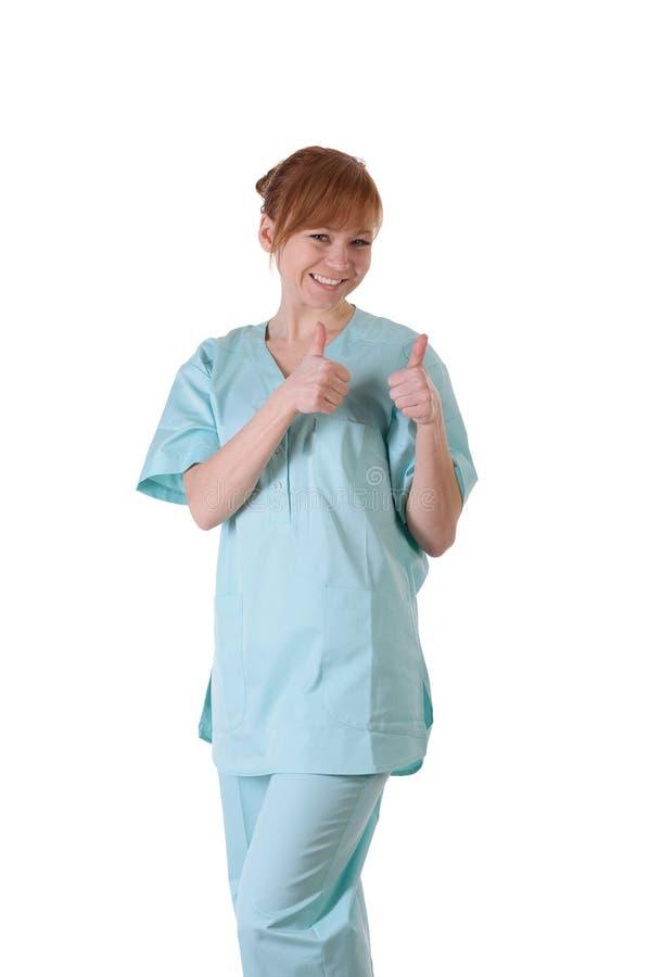 Ευτυχής χαμογελώντας θηλυκός γιατρός με τους αντίχειρες επάνω στη χειρονομία στοκ φωτογραφίες με δικαίωμα ελεύθερης χρήσης