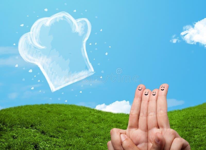 Ευτυχή δάχτυλα προσώπου smiley που εξετάζουν την απεικόνιση του καπέλου μαγείρων στοκ φωτογραφία
