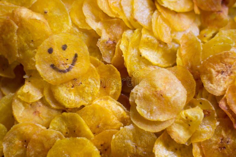Ευτυχή plantain τσιπ στοκ εικόνα