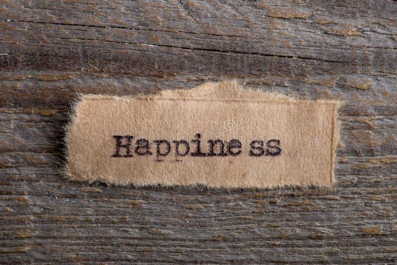 Ευτυχία - λέξη που δακτυλογραφείται ευλογία σας σε ένα κομμάτι χαρτί, έννοια κινήτρου που κινείται για να βρεθεί η προσωπική στοκ φωτογραφία με δικαίωμα ελεύθερης χρήσης