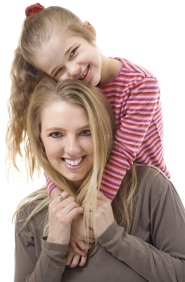 Ευτυχείς μητέρα και κόρη στοκ εικόνα με δικαίωμα ελεύθερης χρήσης