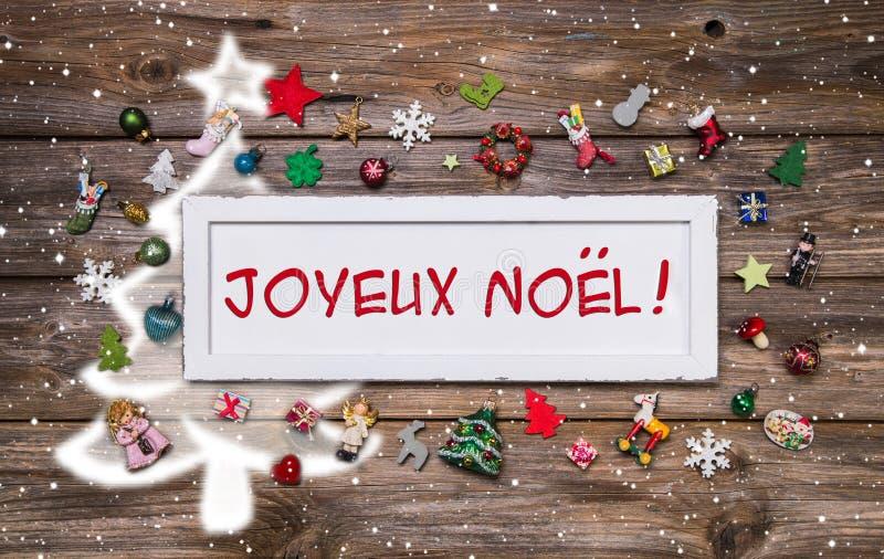 Ευχετήρια κάρτα Χαρούμενα Χριστούγεννας με το γαλλικό κείμενο - διακόσμηση mult στοκ εικόνα με δικαίωμα ελεύθερης χρήσης