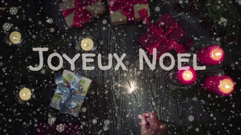 Ευχετήρια κάρτα Joyeux Noel, Χαρούμενα Χριστούγεννα στη γαλλική γλώσσα στοκ εικόνα