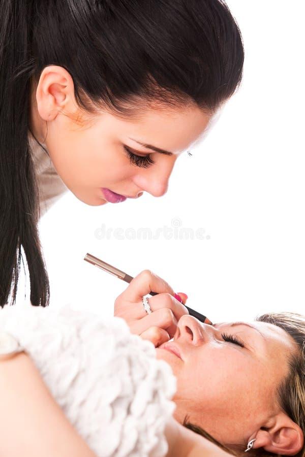 Εφαρμογή των ψεύτικων eyelashes στοκ φωτογραφίες με δικαίωμα ελεύθερης χρήσης
