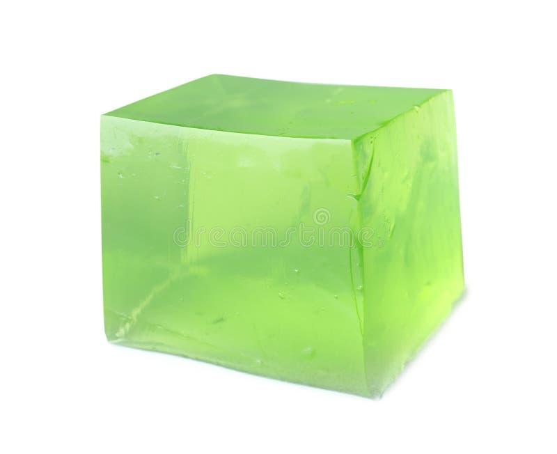 Εύγευστος πράσινος κύβος ζελατίνας στο λευκό στοκ φωτογραφίες