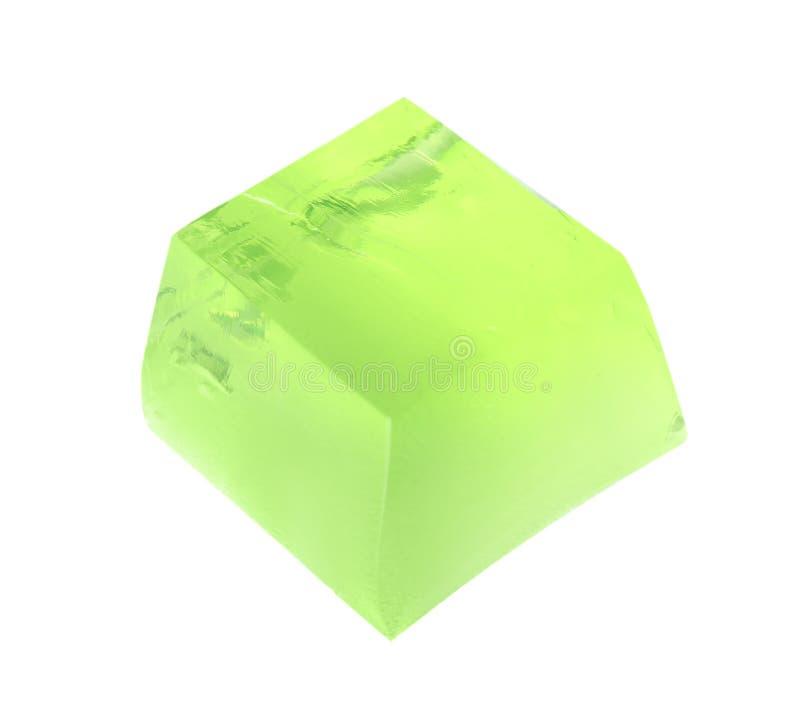 Εύγευστος πράσινος κύβος ζελατίνας στο λευκό στοκ εικόνες