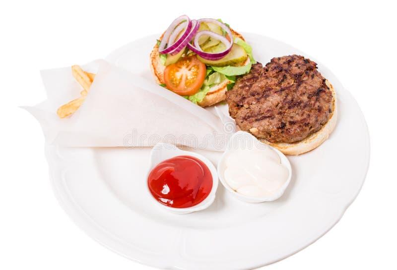 Εύγευστο αμερικανικό ψημένο στη σχάρα burger βόειου κρέατος στοκ εικόνα