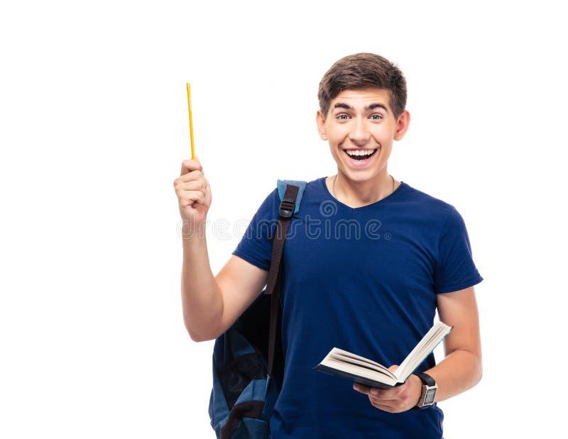 Εύθυμα βιβλίο και μολύβι εκμετάλλευσης ανδρών σπουδαστών στοκ φωτογραφία