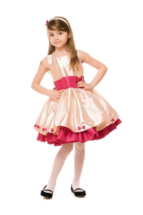 Εύθυμος λίγη κυρία σε ένα φόρεμα στοκ εικόνες