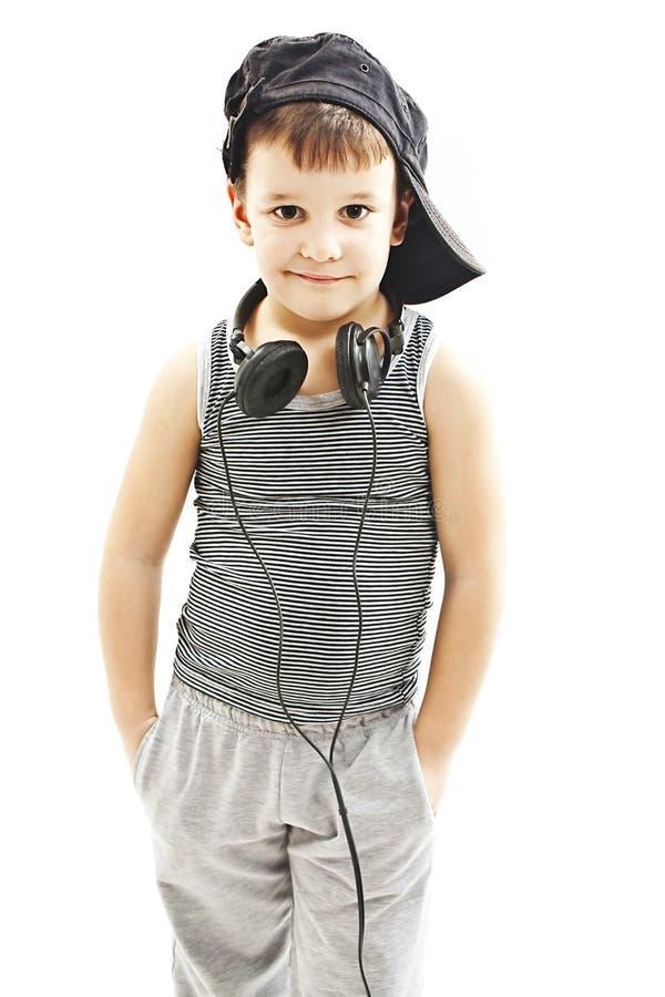 Ελάχιστα deejay αστείο χαμογελώντας αγόρι με τα ακουστικά στοκ εικόνες