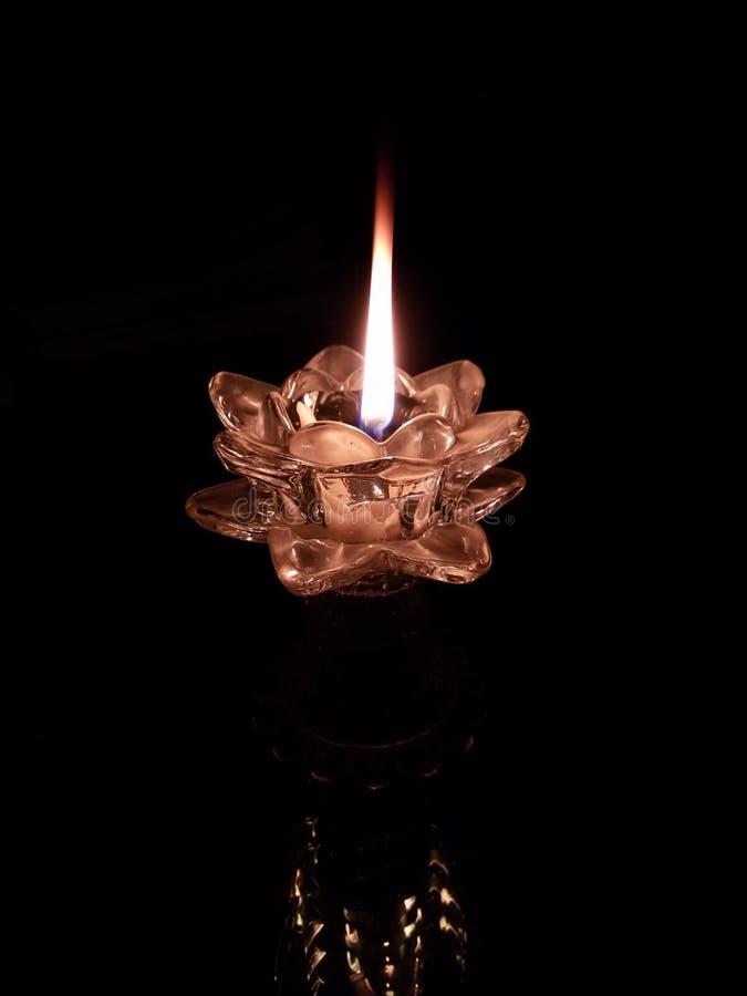 Ελαφριά φλόγα κεριών στοκ φωτογραφίες
