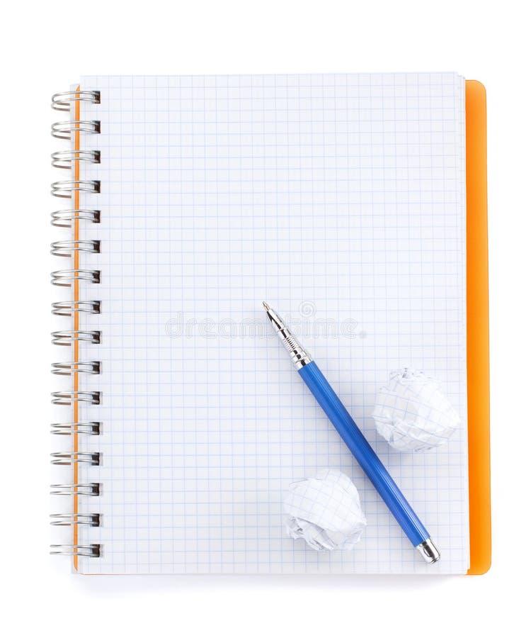 Ελεγχμένο σημειωματάριο στο λευκό στοκ φωτογραφίες