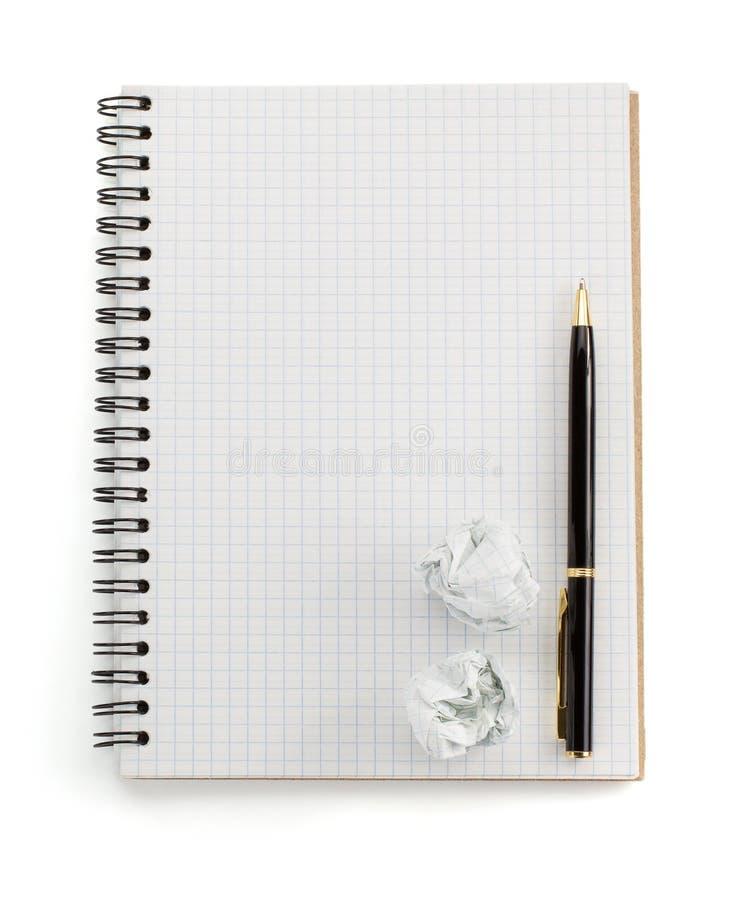 Ελεγχμένο σημειωματάριο στο λευκό στοκ εικόνα