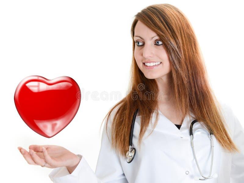 Ελκυστικός κτύπος της καρδιάς ακούσματος γυναικών γιατρών στοκ εικόνες με δικαίωμα ελεύθερης χρήσης