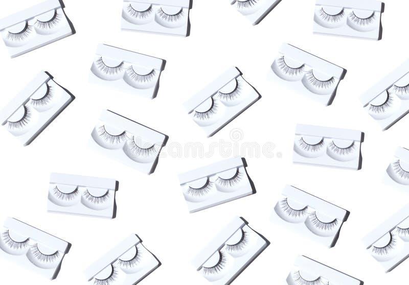 Ζευγάρια του μαύρου ψεύτικου άνευ ραφής σχεδίου eyelashes στο φωτεινό άσπρο υπόβαθρο, στοκ εικόνες