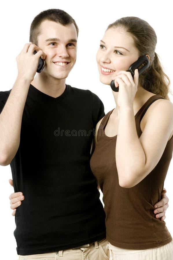 Ζεύγος στα τηλέφωνα στοκ εικόνες