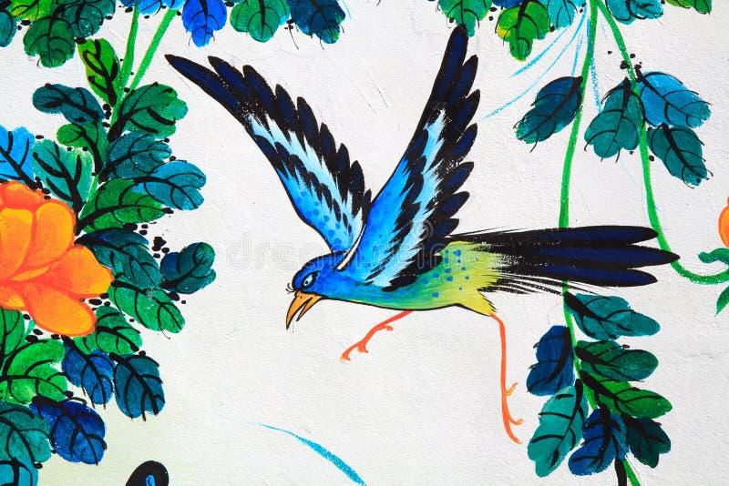 Ζωγραφική πουλιών σε έναν τοίχο στοκ φωτογραφία