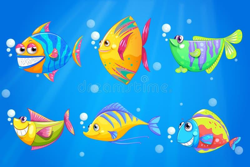 Ζωηρόχρωμα και ψάρια χαμόγελου κάτω από τη θάλασσα απεικόνιση αποθεμάτων
