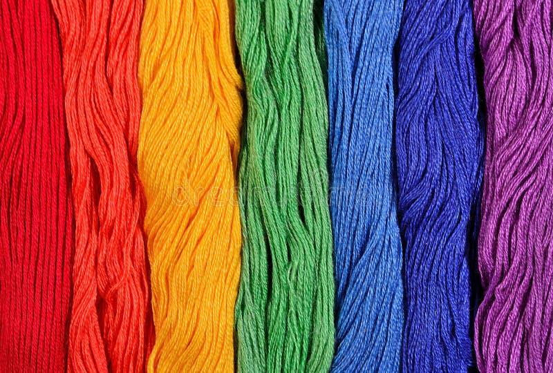 Ζωηρόχρωμα νηματοδέματα του νήματος ως σύσταση υποβάθρου στοκ εικόνα με δικαίωμα ελεύθερης χρήσης