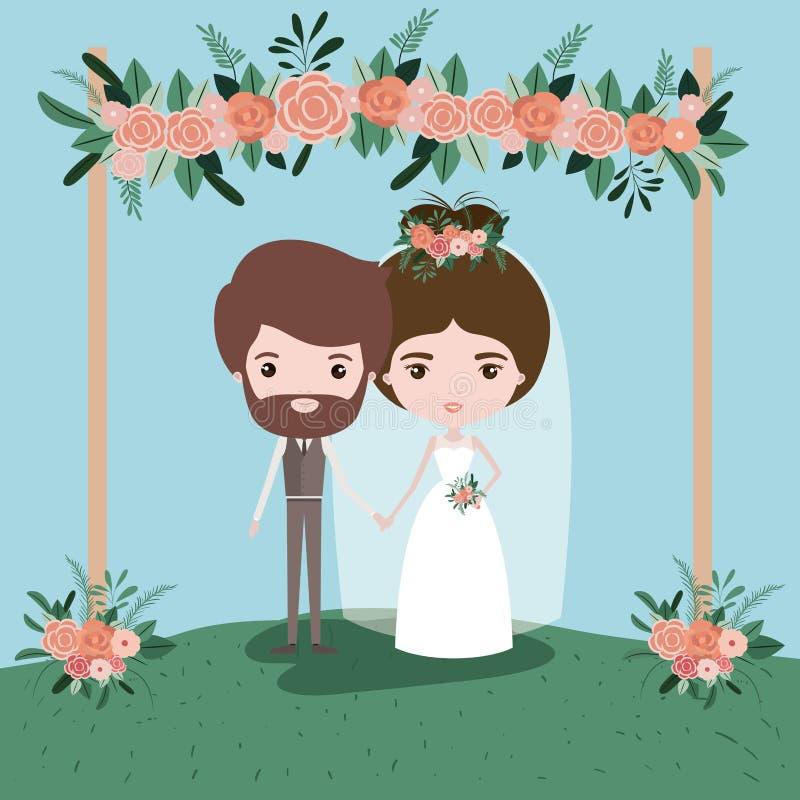 Ζωηρόχρωμη σκηνή με το διακοσμητικό πλαίσιο χλόης με τις floral διακοσμήσεις στο ξύλινο ζεύγος poleswith παντρεμένος ακριβώς κάτω απεικόνιση αποθεμάτων