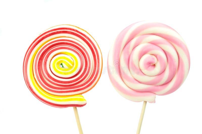 Ζωηρόχρωμη σπείρα lollipops στο άσπρο υπόβαθρο στοκ εικόνες