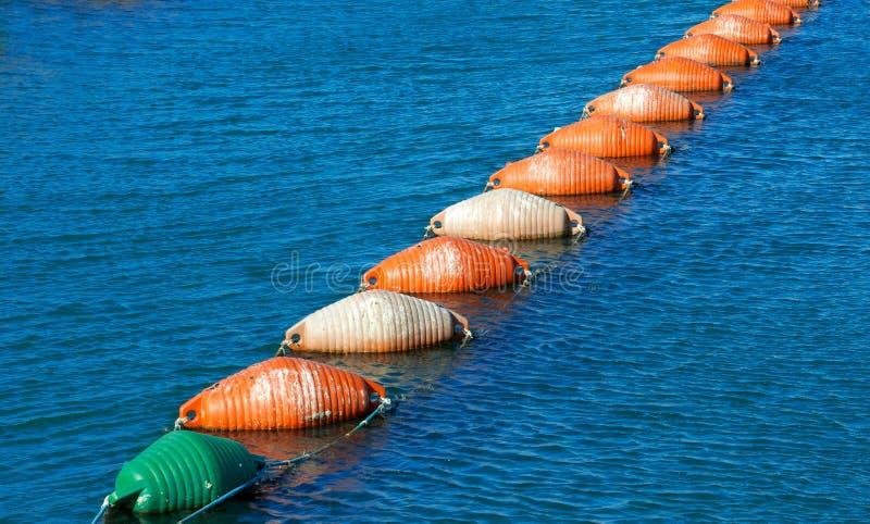 Ζωηρόχρωμοι σημαντήρες αστακών, εργαλείο αλιείας στοκ εικόνα
