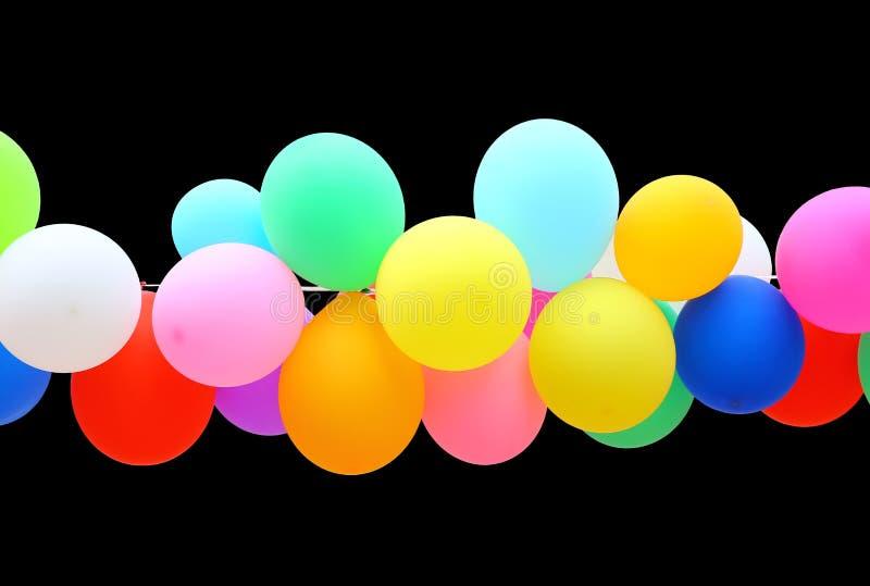 Ζωηρόχρωμο μπαλόνι που απομονώνεται στο μαύρο υπόβαθρο στοκ φωτογραφίες με δικαίωμα ελεύθερης χρήσης