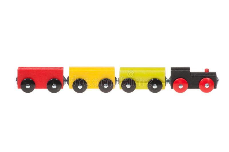 Ζωηρόχρωμο ξύλινο τραίνο παιχνιδιών, που απομονώνεται στο άσπρο υπόβαθρο στοκ εικόνα