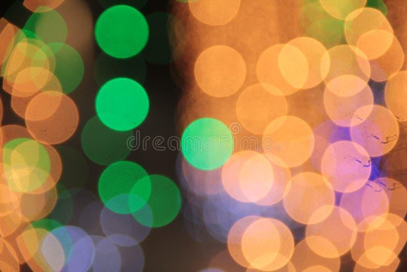 Ζωηρόχρωμο bokeh του ελαφριού υποβάθρου χρώματος στο γεγονός Chrismas στοκ εικόνες