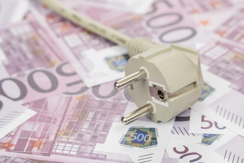 Ηλεκτρικό βούλωμα στα χρήματα στοκ φωτογραφίες