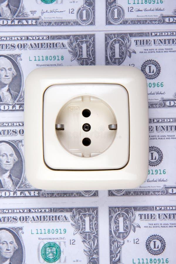 ηλεκτρικό βύσμα χρημάτων στοκ φωτογραφία