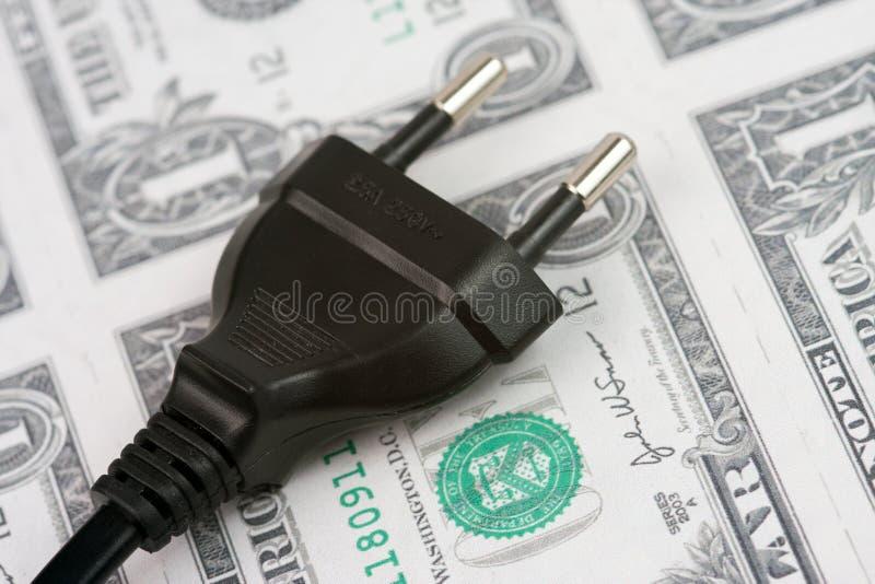 ηλεκτρικό βύσμα χρημάτων στοκ εικόνα με δικαίωμα ελεύθερης χρήσης