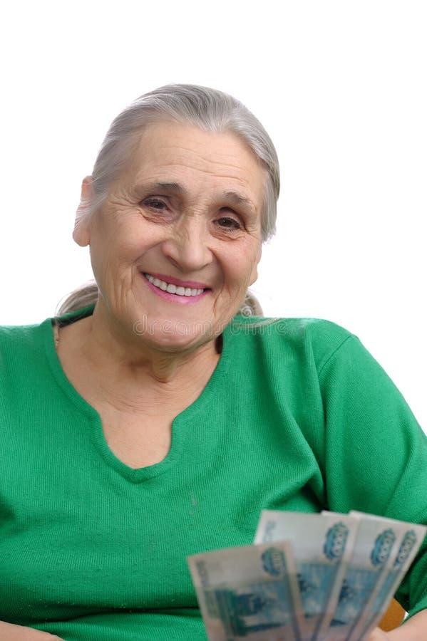 Ηλικιωμένη γυναίκα με τα χρήματα στοκ εικόνες με δικαίωμα ελεύθερης χρήσης
