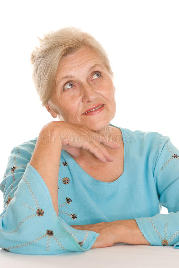 Ηλικιωμένη γυναίκα σε ένα λευκό στοκ φωτογραφίες