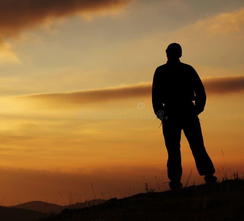 ηλιοβασίλεμα ατόμων ανασκόπησης στοκ εικόνες