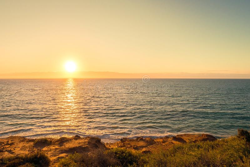 Ηλιοβασίλεμα στην παραλία Noarlunga λιμένων στοκ φωτογραφία με δικαίωμα ελεύθερης χρήσης